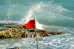 Red flag 2. Red flag and very danger sea stock photo