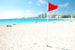 mexico, Red flag in cancun beach Royalty Free Stock Image