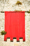 Red flag. Beautiful blank flag at a historic building in italy - nice background with space for text Royalty Free Stock Photos