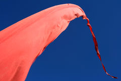 Red flag. A red flag over a clear blue sky Royalty Free Stock Photo