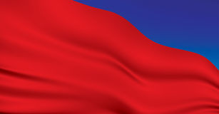 The red flag. Under the red flag flying in the blue sky Royalty Free Stock Images