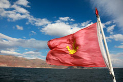 Red flag with anchor sign. On a sailing ship Royalty Free Stock Image