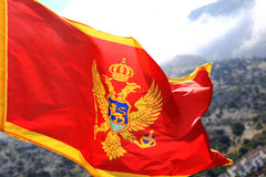 Red flag on  background of mountains Montenegro Stock Photos