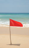 Red flag on beach Stock Photo