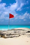 Red flag on the beach Stock Photo