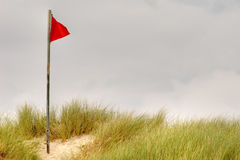 Red flag on beach Royalty Free Stock Photo