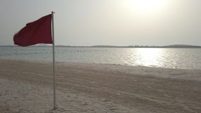 RED FLAG ON SEA SHORE stock video
