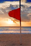Red flag on the beach Royalty Free Stock Photo