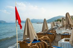 Red flag on the beach of Marmaris, Turkey. Closed in connection with bad weather the beach in Marmaris, 18 AUG, 2017 stock image
