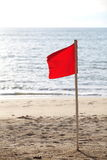 Red flag on the beach Royalty Free Stock Image