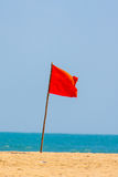 Red Flag on beach. Signalling danger Royalty Free Stock Photo