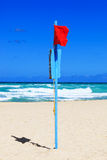 Red flag on beach Royalty Free Stock Images