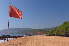 Red flag on the beach Stock Photography