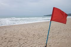 Red flag on the beach. Red flag warning of dangerious seas Stock Images