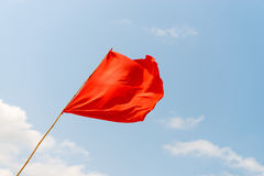 Red flag on the beach. Warning about the dangers. Red flag on the beach, on the background of blue sky. Warning about the dangers royalty free stock photography