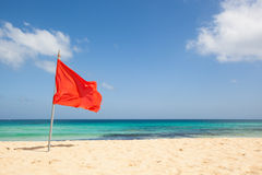 Red flag at the beach Stock Image