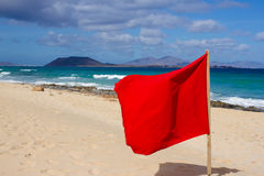 Red flag on beach. Warning sign. Dangerous swim. Safety guard, lifebuoy, lifeguard, life guard. Vacation at ocean. Red flag on beach. Warning sign. Dangerous Royalty Free Stock Images