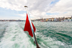 Red flag closeup in the stern boat. Bosphorus, Istanbul. Stock Photos