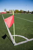 Red flag in corner of soccer field Stock Photo