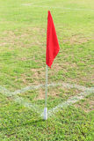 Red flag in corner of soccer field. In sunny day Royalty Free Stock Photography