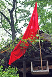 Red flag on cottage Royalty Free Stock Image