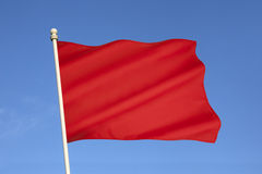 Red Flag of Danger. Often used on beaches to warn swimmers of dangerous sea conditions Stock Photography
