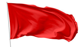 Red flag on flagpole Royalty Free Stock Image