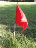 Red flag fluttering. Flag that indicates the side of the soccer field red fluttering royalty free stock images