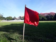 Red flag fluttering. Flag that indicates the side of the soccer field red fluttering royalty free stock image