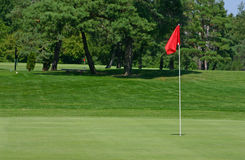 Red Flag Golf Course. Red flag on the green Stock Photography