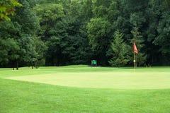 Red flag on a golf course Stock Photos