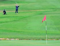 Red flag on golf field Royalty Free Stock Photography