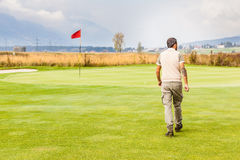 Red flag golf hole. A golf hole with a flag pole in a beautiful golf course Stock Images