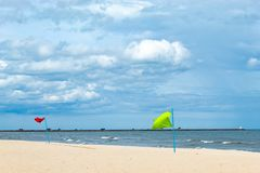 Red flag and green flag embroidered on the beach by the sea. stock images