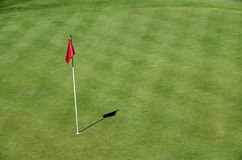 Red flag on Golf in Talloires, Annecy lake, France. Red flag and green lawn on golf on Roc de cheres, in Talloires, Annecy lake, France Stock Photography