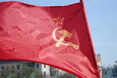 Red flag with a hammer and sickle. Red flag with a star, hammer and sickle. Holiday decoration on the Theatre Square, by the Bolshoi Theater. Victory Day stock photos