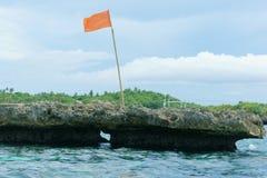 Red flag on island. Boracay Philippine stock images