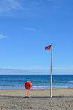 Red flag and lifebuoy Stock Photos