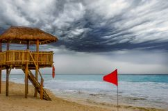 Red Flag and Lifeguard Station stock photography