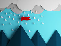 Red flag on the mountain and clouds with rain Stock Photo