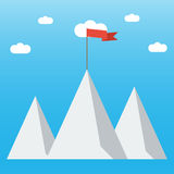 Red flag on a Mountain peak. Concept business and success. Red flag on a Mountain peak. Concept business and success Royalty Free Stock Image