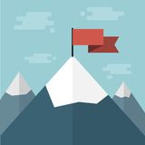 Red flag on mountain top Stock Photo