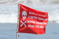 Red Flag with No Swimming Sign . Royalty Free Stock Images