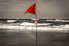 Red flag in ocean in selective color B&W during Surf competition, Lacanau, France. Red flag in ocean in selective color B&W, Lacanau, France Royalty Free Stock Photography