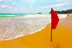 Red flag in phuket beach Royalty Free Stock Photography