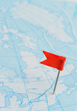 Red flag a pin on blue map Stock Images