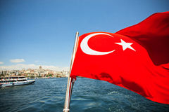 Red flag of the Republic of Turkey. Bright red flag of the Republic of Turkey waving in the wind over the Bosporus stock photo