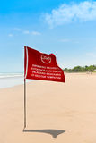 Red flag on the sand beach Stock Photo