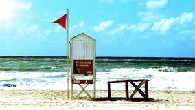 Red Flag in the Sea. Red flag warns swimmers there is danger at sea stock video footage