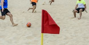 Red flag signaling a corner of a beach soccer field Royalty Free Stock Image